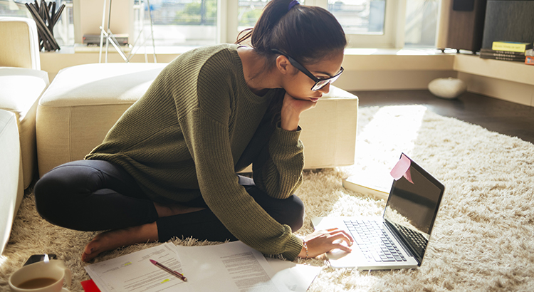women reviewing paperwork and laptop