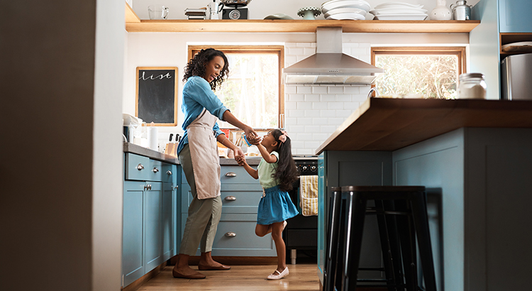 Mom and Daughter dancing in the kitchen