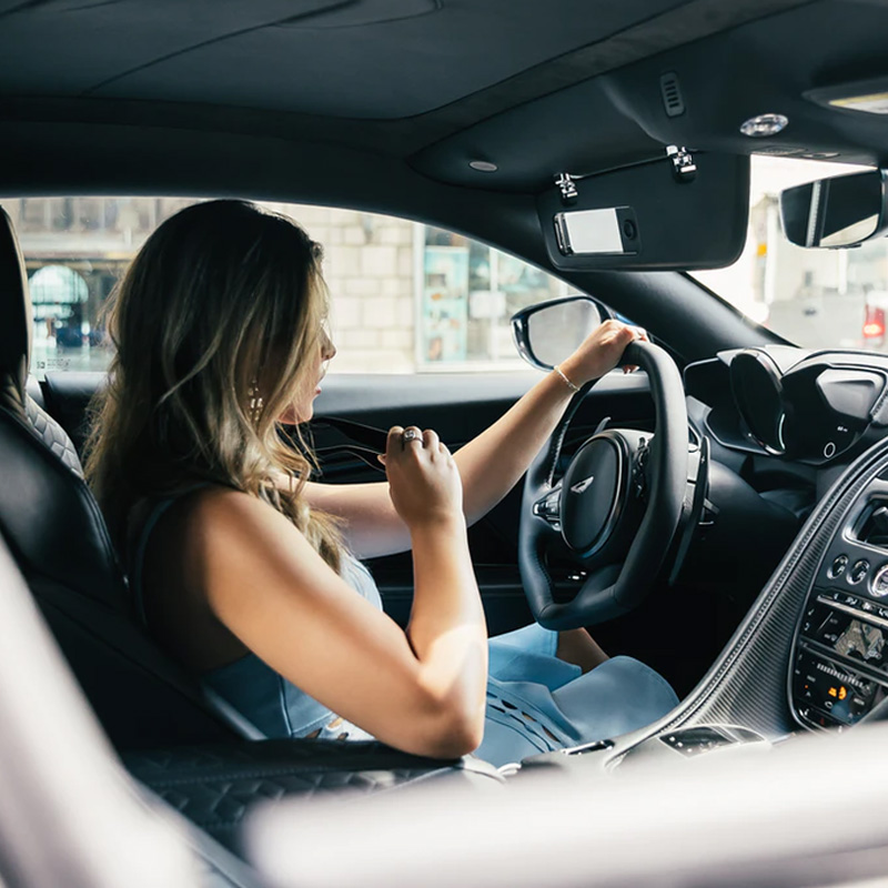 woman wearing white tank top driving car