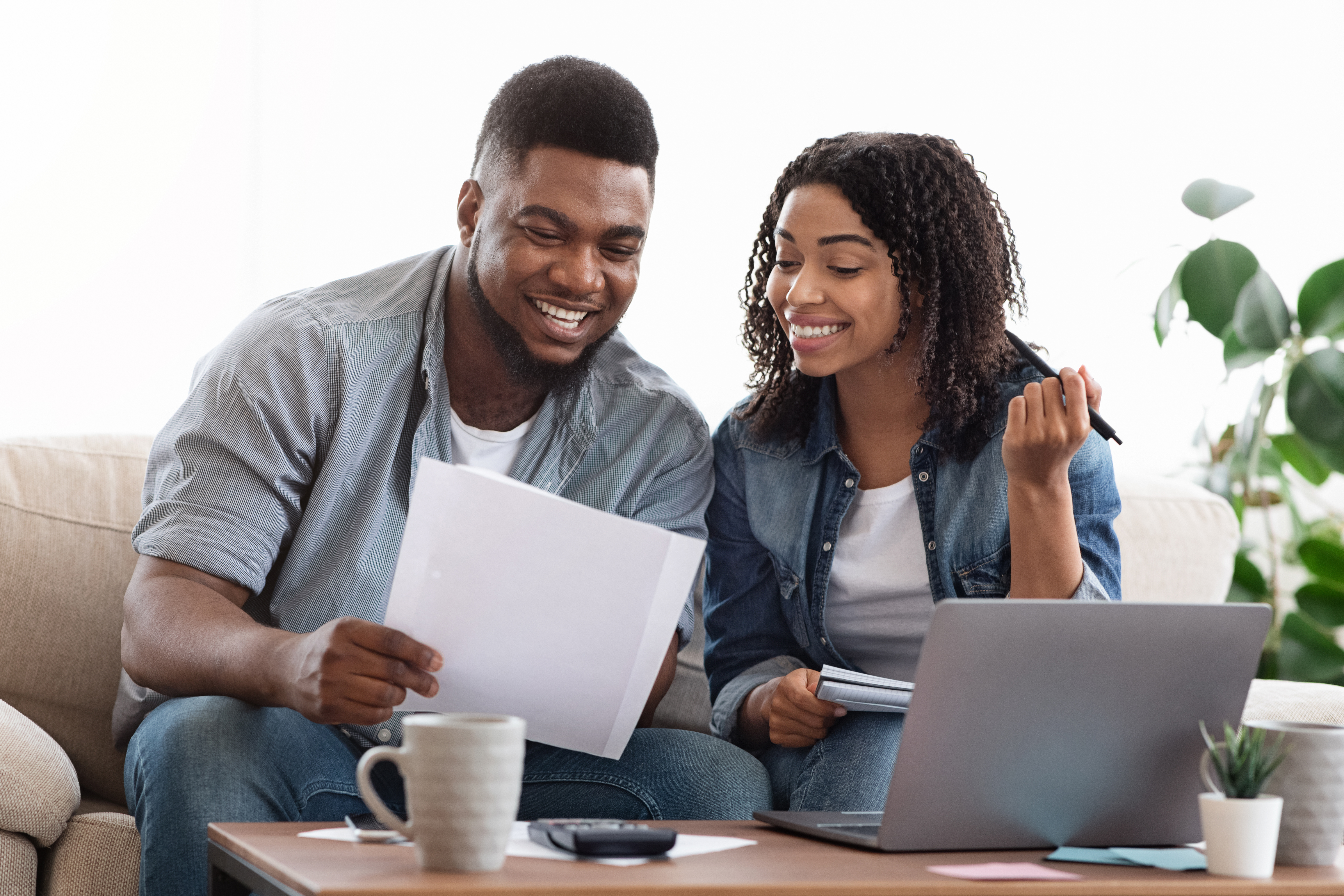 Couple looking over financial statements